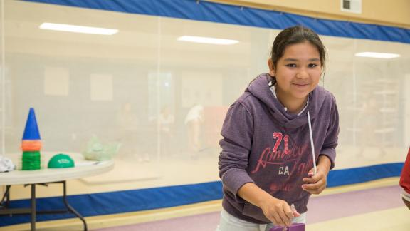 Young girl painting at Akwesasne Boys + Girls Club