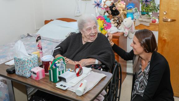 Clifton Fine Hospital volunteer with resident
