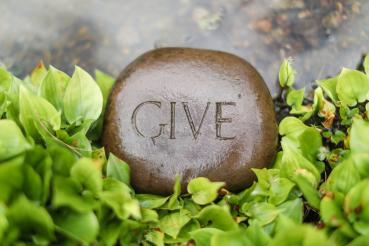 Rock engraved with the word give